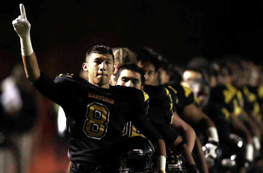 Hastings' Tom Dinh acknowledges the crowd after the playing of the national anthem before a high school football game against Alief Taylor, Friday, November 8, 2013 at Crump Stadium in Houston. Photo: Eric Christian Smith, For The Chronicle