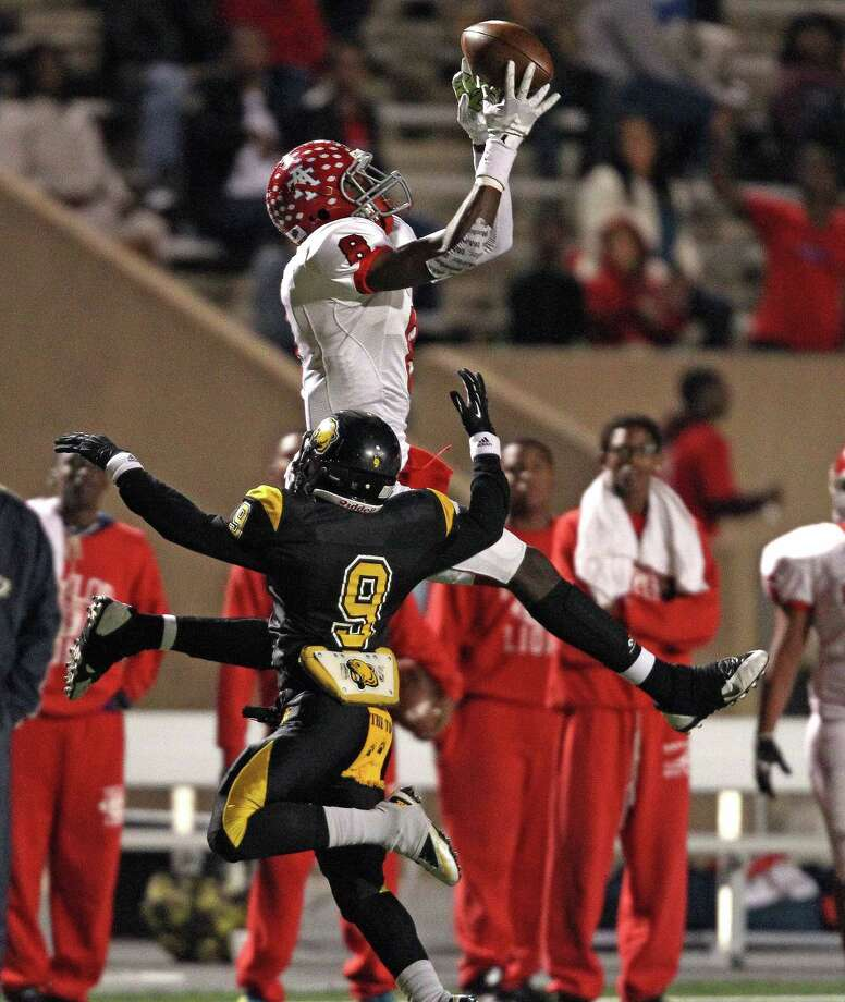 Alief Taylor's Keenen Brown (8) makes a leaping reception over Hastings' Warren Howard during the first half of a high school football game, Friday, November 8, 2013 at Crump Stadium in Houston. Photo: Eric Christian Smith, For The Chronicle