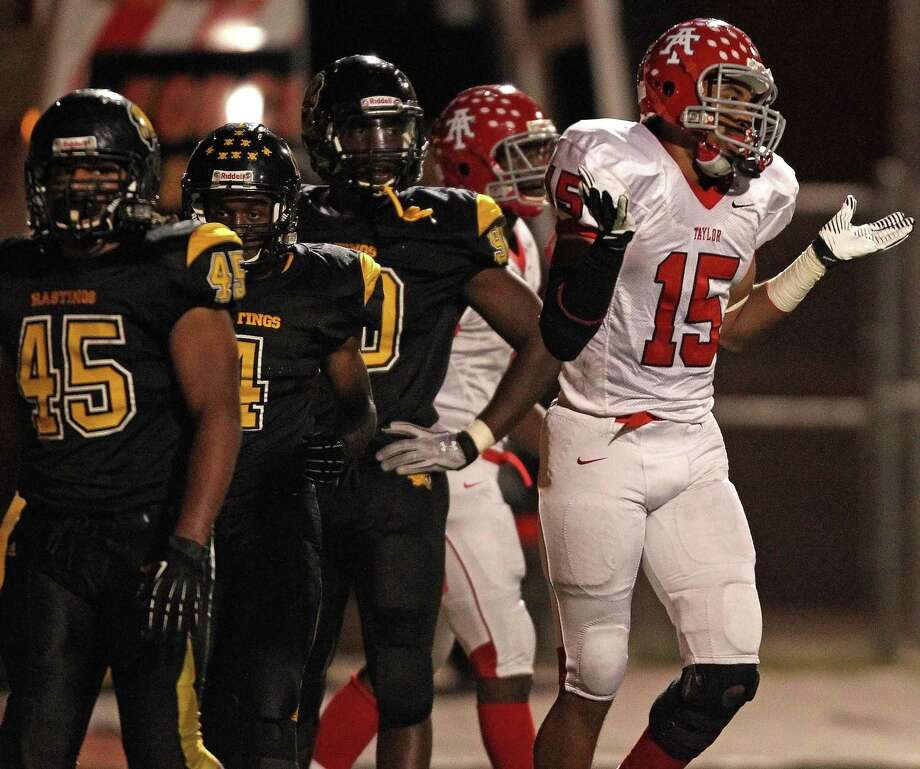 Alief Taylor's Romello Brooker (15) gestures after scoring a touchdown during the first half of a high school football game against Hastings, Friday, November 8, 2013 at Crump Stadium in Houston. Photo: Eric Christian Smith, For The Chronicle