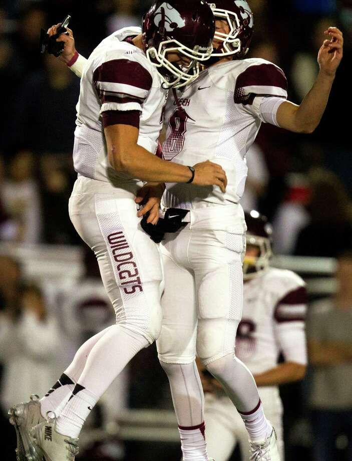 Clear Creek quarterback Jarrett Hildreth, (left) celebrates with his brother Chase after running back Kaliq Kokuma (4) scores a touchdown during the first half of a high school football game against Clear Springs at CCISD Veterans Stadium on Friday, Nov. 8, 2013, in League City. Photo: J. Patric Schneider, For The Chronicle / © 2013 Houston Chronicle