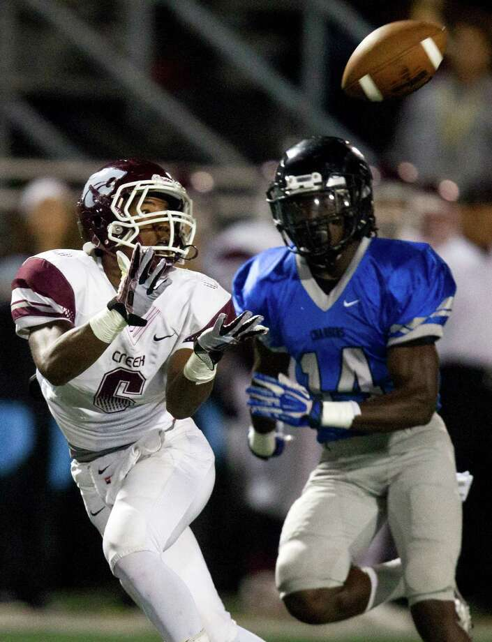 Clear Creek wide receiver Davon Smith (6) catches a pass past Clear Springs defender Joshua Washington (14) during the first half of a high school football game at CCISD Veterans Stadium on Friday, Nov. 8, 2013, in League City. Photo: J. Patric Schneider, For The Chronicle / © 2013 Houston Chronicle