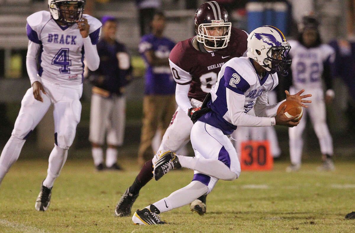 Brackenridge's Olajuwon Reese (02) sprints for yardage after an interception as Highlands' Chris Hernandez attempts a tackle at SAISD Spring Sports Complex on Friday, Nov. 8, 2013.