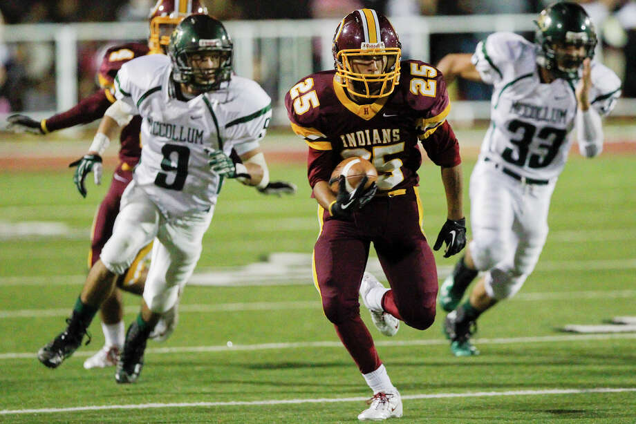 Harlandale's John Aguirre (25) breaks free into the Cowboy secondary as McCollum's Chris Herrera (left) and John Martinez give chase during the second half of the 50th annual Frontier Bowl between Harlandale and McCollum at Harlandale Memorial Stadium on Friday, Nov. 8, 2013.  Harlandale beat the Coyboys 27-17.  MARVIN PFEIFFER/ mpfeiffer@express-news.net Photo: MARVIN PFEIFFER, Marvin Pfeiffer/ Express-News / Express-News 2013