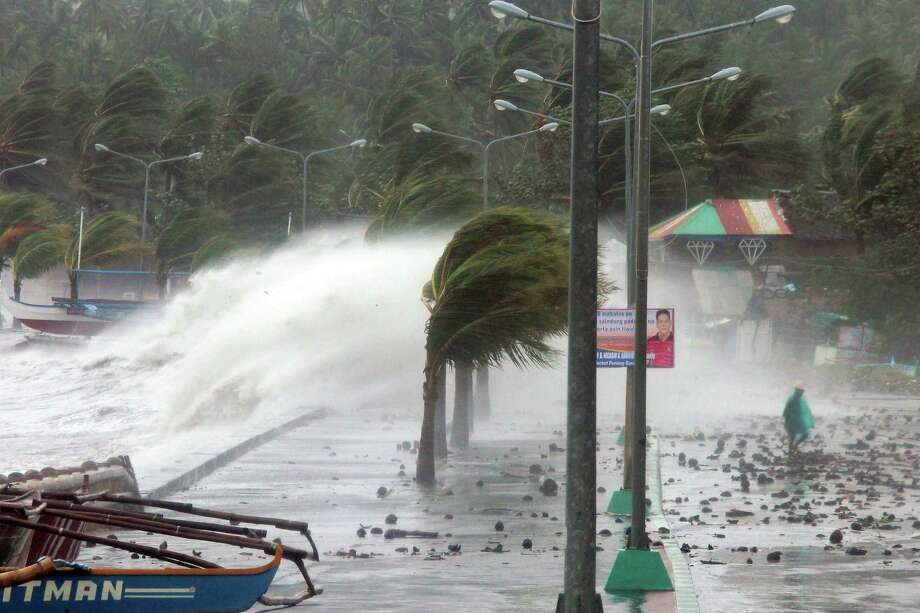 High waves pound the sea wall amidst strong winds as Typhoon Haiyan, one of the most intense on record, hit the city of Legazpi, Albay province, south of Manila on Friday. Photo: Charism Sayat / Getty Images