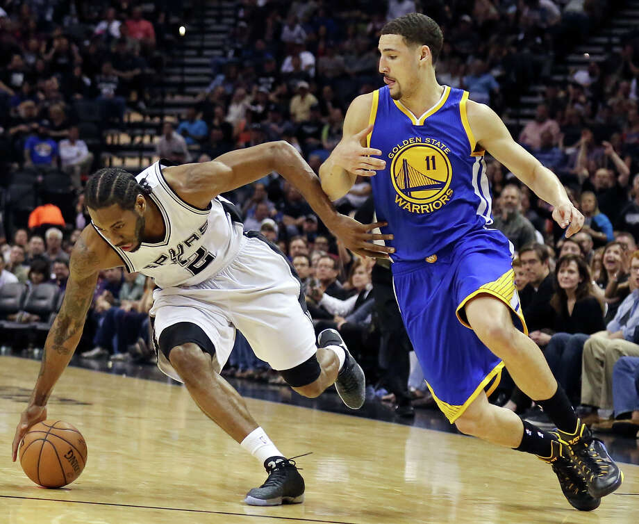 San Antonio Spurs' Kawhi Leonard grabs for a loose ball around Golden State Warriors' Klay Thompson during first half action Sunday April 5, 2015 at the AT&T Center. Photo: Edward A. Ornelas, San Antonio Express-News / © 2015 San Antonio Express-News