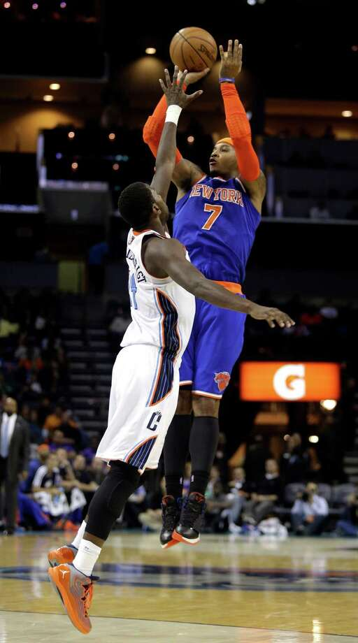 New York Knicks forward Carmelo Anthony (7) shoots over Charlotte Bobcats forward Michael Kidd-Gilchrist in the second half of an NBA basketball game in Charlotte, N.C., Friday, Nov. 8, 2013. New York won 101-91. (AP Photo/Nell Redmond) ORG XMIT: NCNR106 Photo: Nell Redmond / FR25171 AP