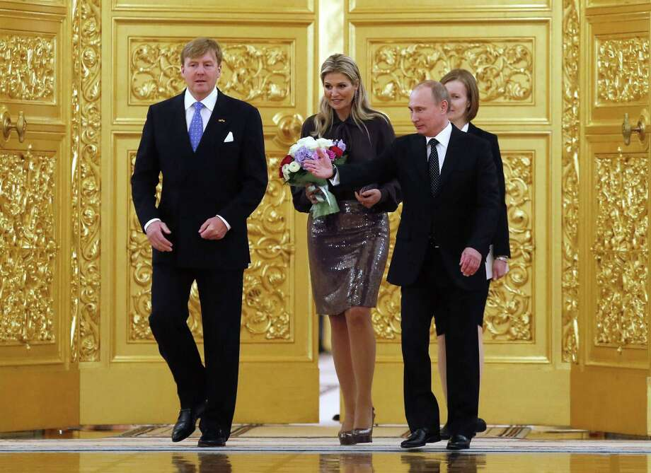 King Willem-Alexander (from left) and Queen Maxima meet Russia President Vladimir Putin on Friday in Moscow. Relations between Holland and Russia are strained because of Russia seizing a Dutch-flagged Greenpeace ship and arresting all on board. Photo: Yuri Kochetkov / Getty Images