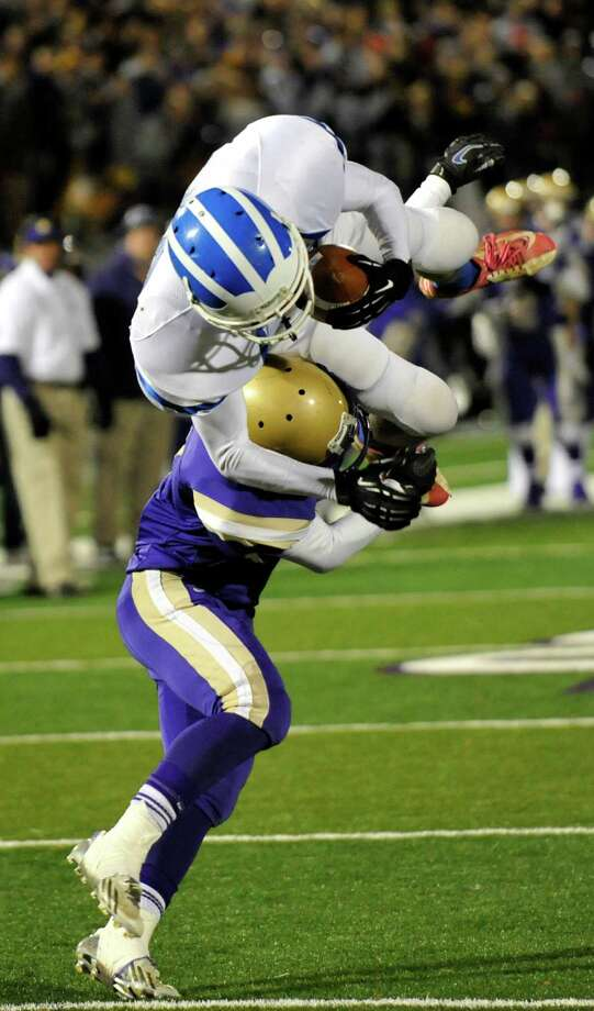 Christian Brothers Academy's Jonas Neri puts the game ending tackle on Shaker's Andrew Bolton ,top, for a 13-8 win over Shaker during their Class AA High School Super Bowl football game in Albany, N.Y., Friday, Nov. 8, 2013. (Hans Pennink / Special to the Times Union) ORG XMIT: HP106 Photo: Hans Pennink / Hans Pennink