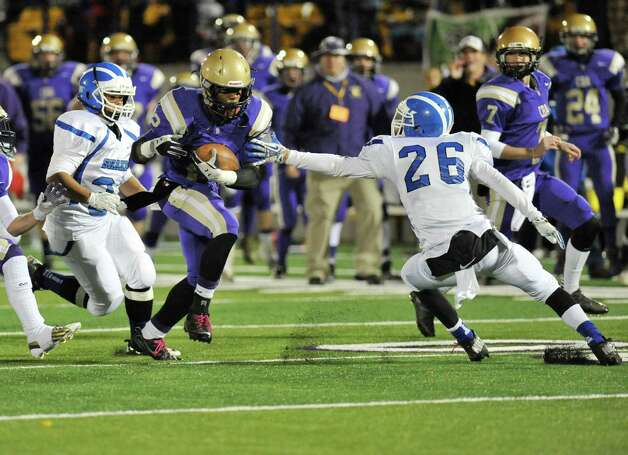 Christian Brothers Academy's Elliot Crosky runs the ball against Shaker during their Class AA High School Super Bowl football game in Albany, N.Y., Friday, Nov. 8, 2013. (Hans Pennink / Special to the Times Union) ORG XMIT: HP111 Photo: Hans Pennink / Hans Pennink