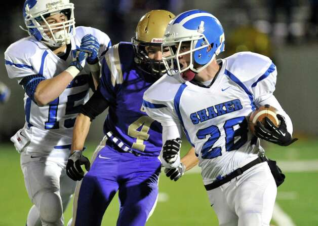 Shaker's  Michael Lewis (28) runs the ball againstChristian Brothers Academy during their Class AA High School Super Bowl football game in Albany, N.Y., Friday, Nov. 8, 2013. (Hans Pennink / Special to the Times Union) ORG XMIT: HP109 Photo: Hans Pennink / Hans Pennink
