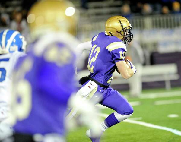 Christian Brothers Academy's Ryan O'Hagan runs for a touchdown against Shaker during their Class AA High School Super Bowl football game in Albany, N.Y., Friday, Nov. 8, 2013. (Hans Pennink / Special to the Times Union) ORG XMIT: HP107 Photo: Hans Pennink / Hans Pennink