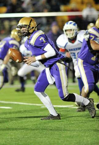 Christian Brothers Academy quarterback Joe Kolbe moves the ball against Shaker during their Class AA High School Super Bowl football game in Albany, N.Y., Friday, Nov. 8, 2013. (Hans Pennink / Special to the Times Union) ORG XMIT: HP108 Photo: Hans Pennink / Hans Pennink