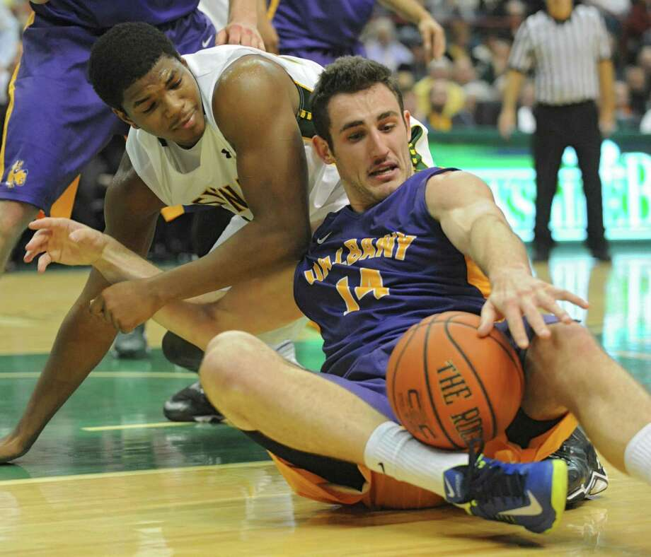 Siena's Lavon Long, left, and UAlbany's Sam Rowley battle for possession of the ball during a basketball game at the Times Union Center  Friday, Nov. 8, 2013 in Albany, N.Y. (Lori Van Buren / Times Union) Photo: Lori Van Buren / 00024543A