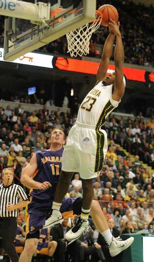 Siena's Maurice White is fouled by UAlbany's Luke Devlin during a basketball game at the Times Union