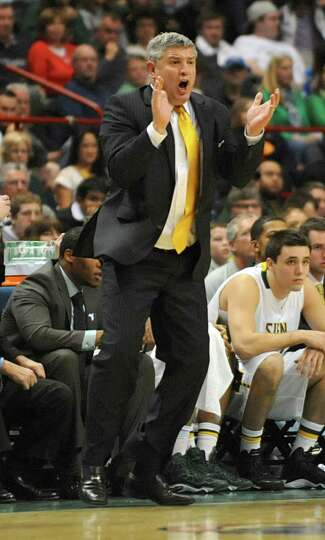Siena head coach Jimmy Pastos yells from sideline during a basketball game against UAlbany at the Ti