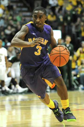 UAlbany's DJ Evans takes the ball down the court during a basketball game against Siena at the Times