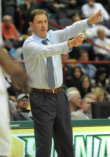 UAlbany head coach Will Brown gives direction from the sideline during a basketball game against Sie