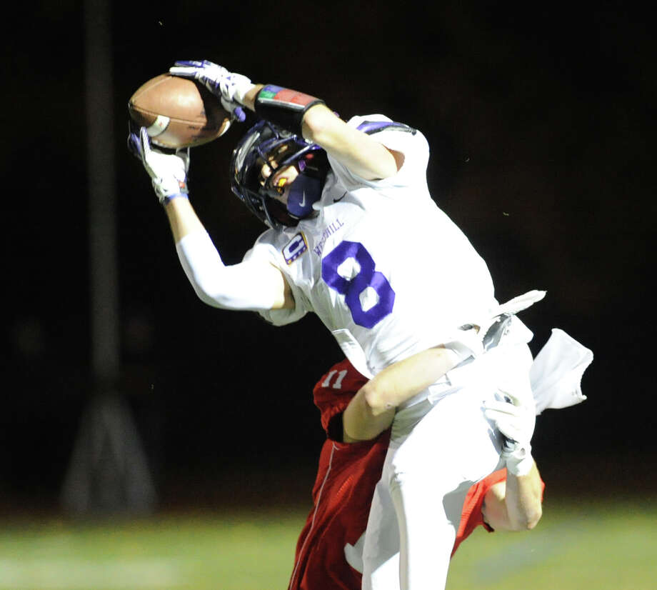 Dante Fargnoli (# 8) of Westhill makes a reception during the High school football game between Greenwich High School and Westhill High School at Greenwich, Friday, Nov. 8, 2013. Photo: Bob Luckey / Greenwich Time