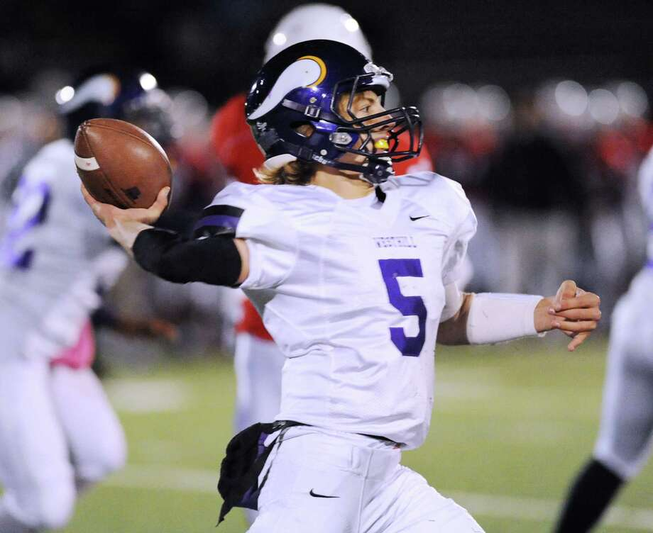 Westhill quarterback Ryan Coppola (# 5), throws during the high school football game between Greenwich High School and Westhill High School at Greenwich, Friday, Nov. 8, 2013. Photo: Bob Luckey / Greenwich Time