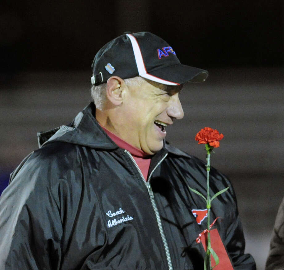 Greenwich football coach Rich Albonizio holds a red carnation as part of Senior Tribute Night honoring the players and their parents prior to the start of the High school football game between Greenwich High School and Westhill High School at Greenwich, Friday, Nov. 8, 2013. Photo: Bob Luckey / Greenwich Time