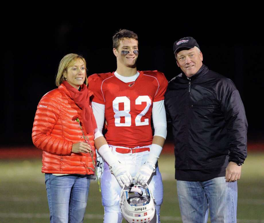 Jack Harrington (# 82) of Greenwich with his parnets, Kathy and Scott, prior to the start of the High school football game between Greenwich High School and Westhill High School at Greenwich, Friday, Nov. 8, 2013. Photo: Bob Luckey / Greenwich Time