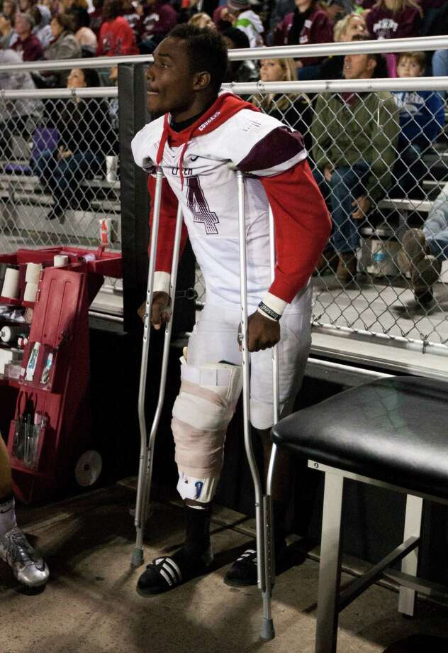 Clear Creek running back Kaliq Kokuma (4) watches from the sidelines after being injured in the first half of a high school football game against Clear Springs at CCISD Veterans Stadium on Friday, Nov. 8, 2013, in League City. Photo: J. Patric Schneider, For The Chronicle / © 2013 Houston Chronicle
