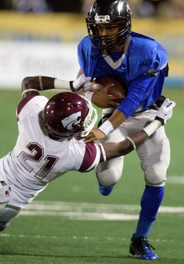 Clear Springs' Matt Guidry avoids a tackle from Clear Creek's Ben Sutton (21) during the first half of a high school football game at CCISD Veterans Stadium on Friday, Nov. 8, 2013, in League City. Photo: J. Patric Schneider, For The Chronicle / © 2013 Houston Chronicle