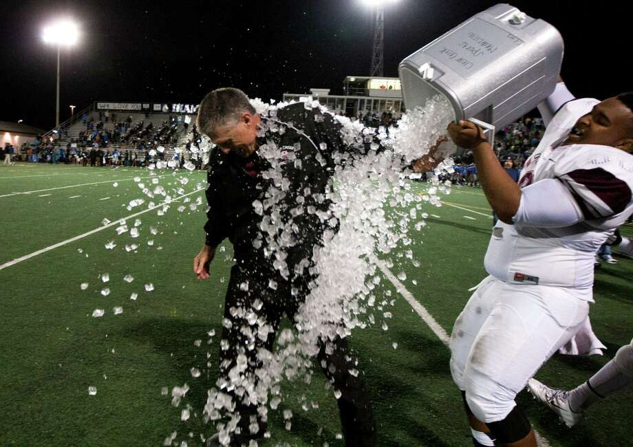 Clear Creek head coach Darrell Warden is drenched by Bailey Burton after defeating Clear Springs 63-62 in double overtime during a high school football game at CCISD Veterans Stadium on Friday, Nov. 8, 2013, in League City. Photo: J. Patric Schneider, For The Chronicle / © 2013 Houston Chronicle
