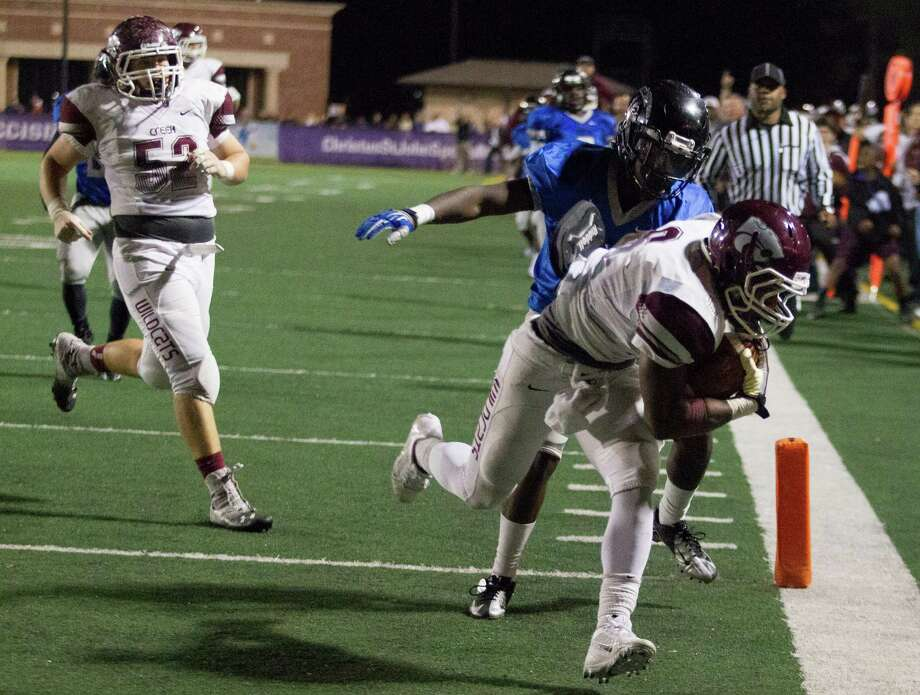 Clear Creek wide receiver Davon Smith scores a touchdown in double overtime against Clear Springs during a high school football game at CCISD Veterans Stadium on Friday, Nov. 8, 2013, in League City. Photo: J. Patric Schneider, For The Chronicle / © 2013 Houston Chronicle