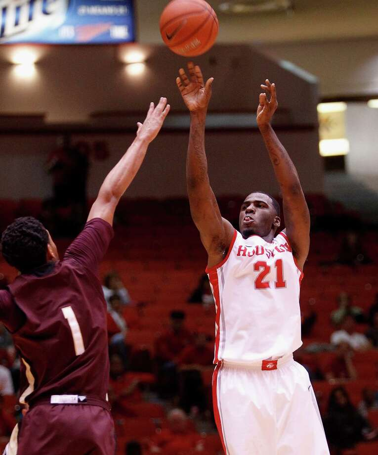Houston Cougars guard Jherrod Stiggers  shoots over Texas State Bobcats forward Kavin Gilder-Tilbury in the first half during an NCAA mens basketball game between the Texas State Bobcats and the University of Houston Cougars at Hofheinz Pavilion, Friday, Nov. 8, 2013. (Bob Levey/Special to the Chronicle) Photo: Bob Levey, Houston Chronicle / ©2013 Bob Levey