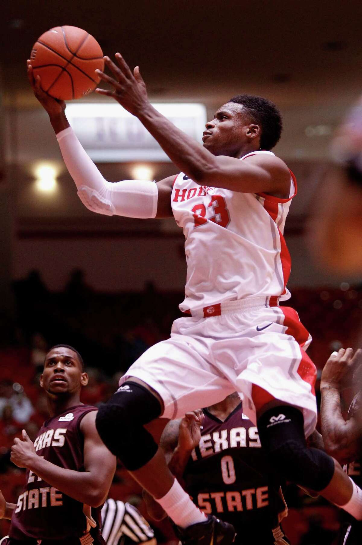Houston Cougars guard Danuel House drives to the basket past Texas State Bobcats forward Emani Gant in the first halfd during an NCAA mens basketball game between the Texas State Bobcats and the University of Houston Cougars at Hofheinz Pavilion, Friday, Nov. 8, 2013. (Bob Levey/Special to the Chronicle)