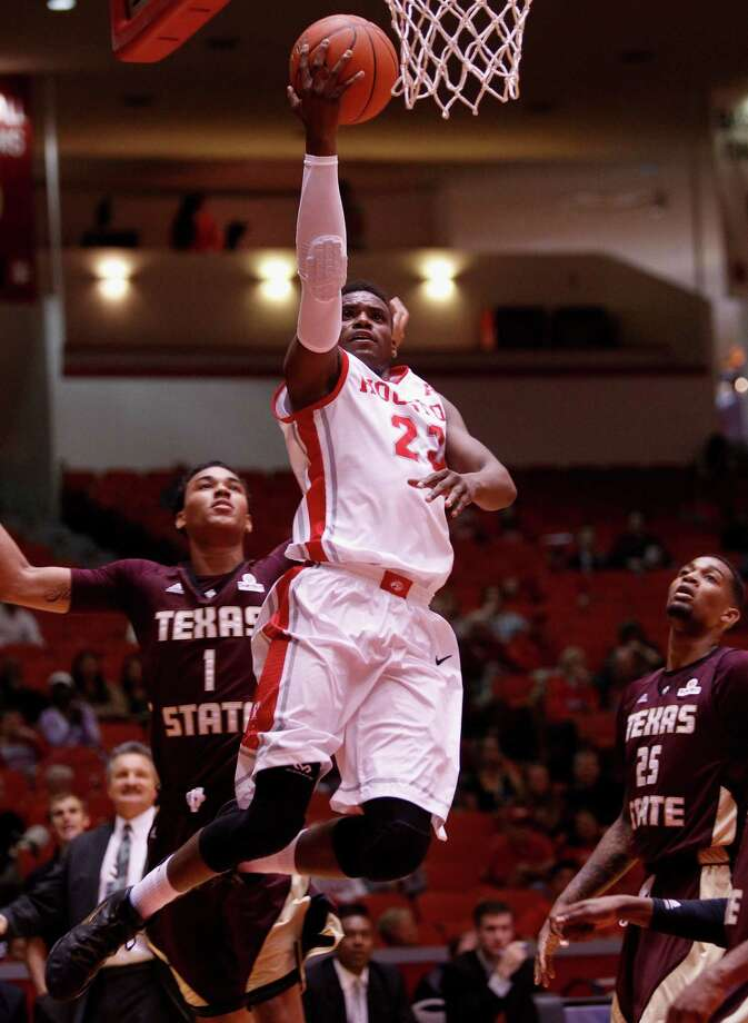 Houston Cougars guard Danuel House  drives baseline past Texas State Bobcats forward Kavin Gilder-Tilbury  for a layup in the first half during an NCAA mens basketball game between the Texas State Bobcats and the University of Houston Cougars at Hofheinz Pavilion, Friday, Nov. 8, 2013. (Bob Levey/Special to the Chronicle) Photo: Bob Levey, Houston Chronicle / ©2013 Bob Levey