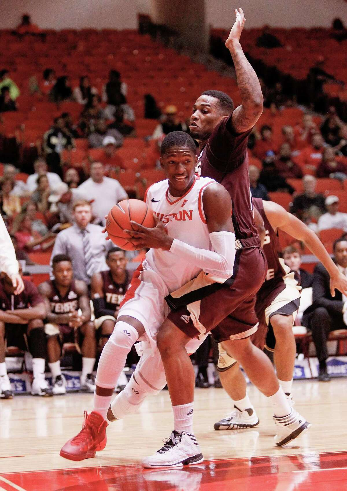 Houston Cougars forward Mikhail McLean drives around Texas State Bobcats forward Corey Stern in the first half during an NCAA mens basketball game between the Texas State Bobcats and the University of Houston Cougars at Hofheinz Pavilion, Friday, Nov. 8, 2013. (Bob Levey/Special to the Chronicle)