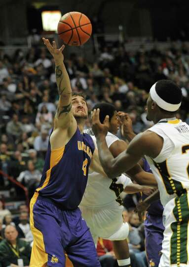 UAlbany's Levan Shengelia snags a rebound during a basketball game against Siena at the Times Union