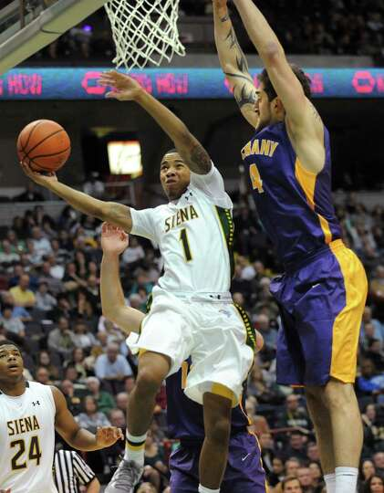 Siena's Marquis Wright takes guarded by UAlbany's Levan Shengelia during a basketball game at the Ti