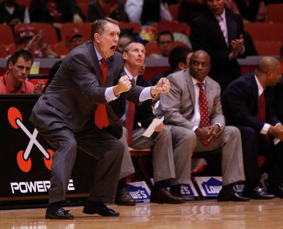 Houston Cougars head coach James Dickey urges his team on in the first half during an NCAA mens basketball game between the Texas State Bobcats and the University of Houston Cougars at Hofheinz Pavilion, Friday, Nov. 8, 2013. (Bob Levey/Special to the Chronicle) Photo: Bob Levey, Houston Chronicle / ©2013 Bob Levey