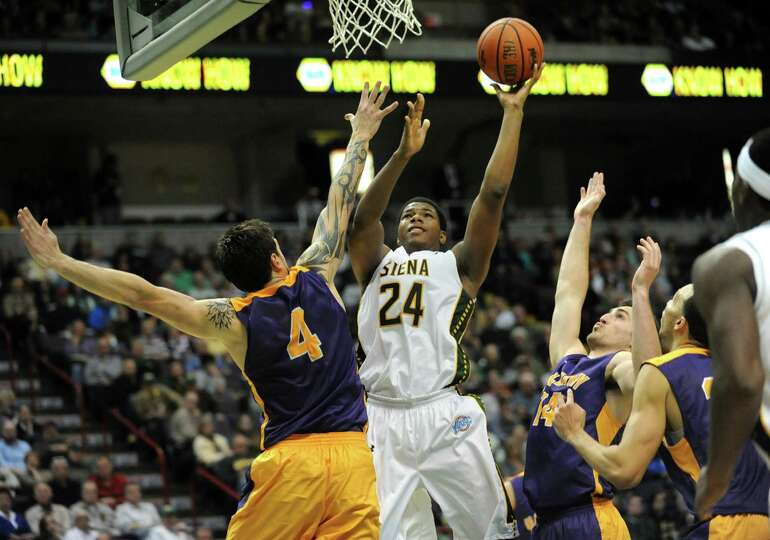 Siena's Lavon Long takes a shot against UAlbany's Levan Shengelia  during a basketball game at the T