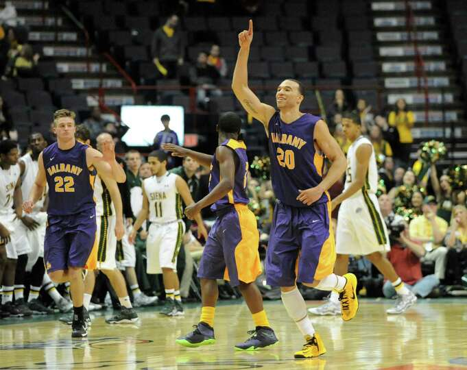 UAlbany runs off the court after coming back to  win a basketball game against Siena at the Times Un