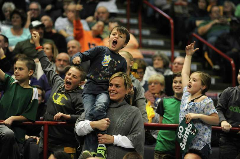 Fans cheer during a Siena vs UAlbany basketball game at the Times Union Center Friday, Nov. 8, 2013