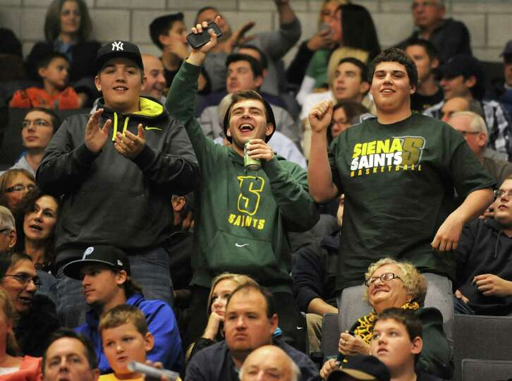Siena Saints fans cheer during a Siena vs UAlbany basketball game at the Times Union Center Friday,