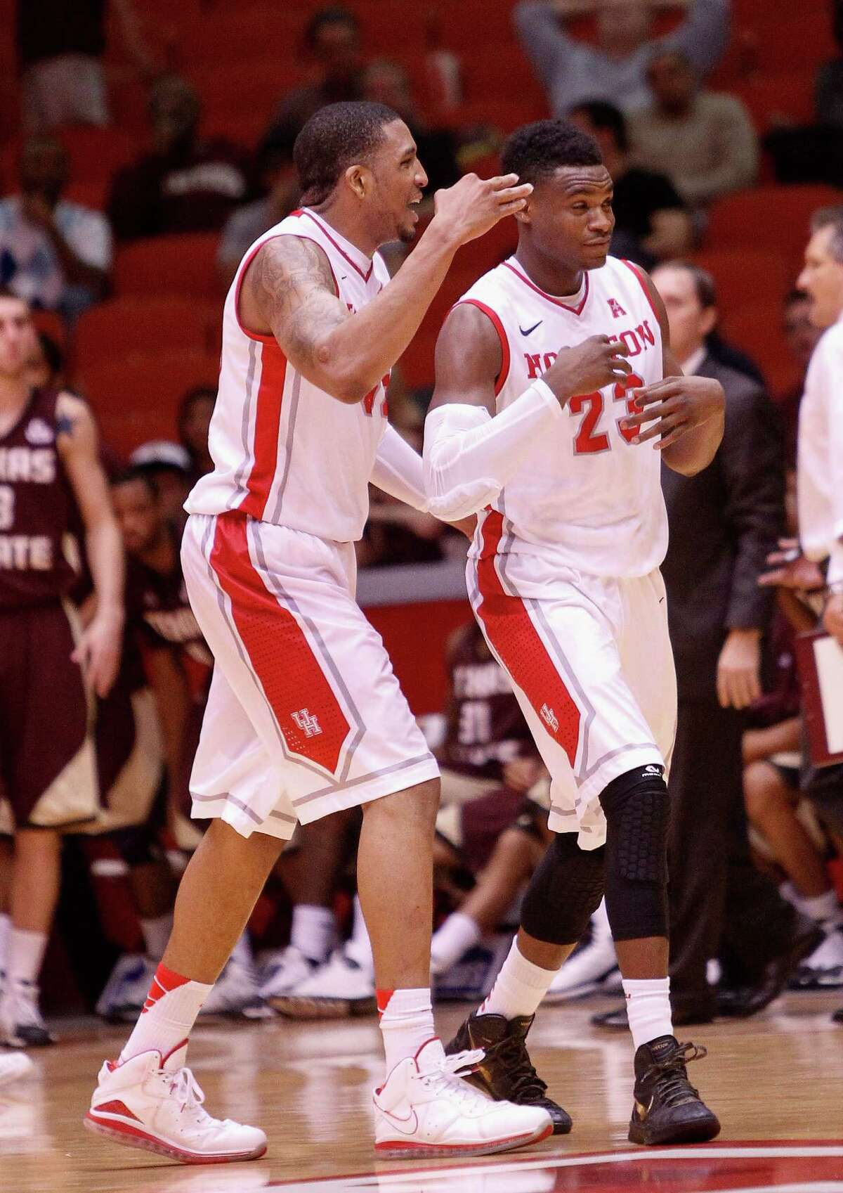 Houston Cougars guard Danuel House is congratulated by TaShawn Thomas after hitting a three point shot to give the Houston Cougars a cushion late in the second half during an NCAA mens basketball game between the Texas State Bobcats and the University of Houston Cougars at Hofheinz Pavilion, Friday, Nov. 8, 2013. (Bob Levey/Special to the Chronicle)