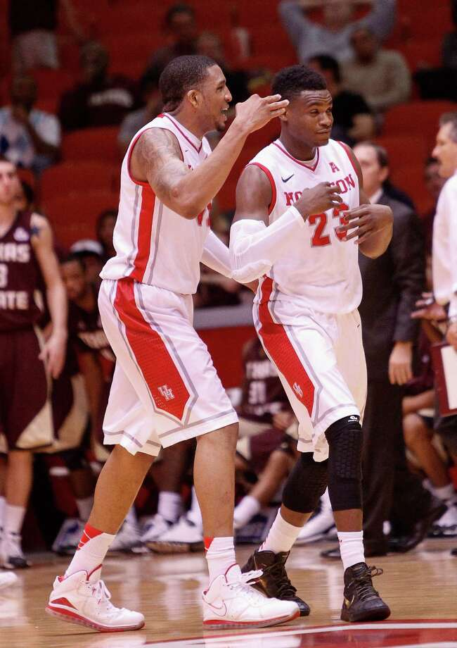 Houston Cougars guard Danuel House  is congratulated by TaShawn Thomas after hitting a  three point shot to give the Houston Cougars a cushion late in the second half during an NCAA mens basketball game between the Texas State Bobcats and the University of Houston Cougars at Hofheinz Pavilion, Friday, Nov. 8, 2013. (Bob Levey/Special to the Chronicle) Photo: Bob Levey, Houston Chronicle / ©2013 Bob Levey