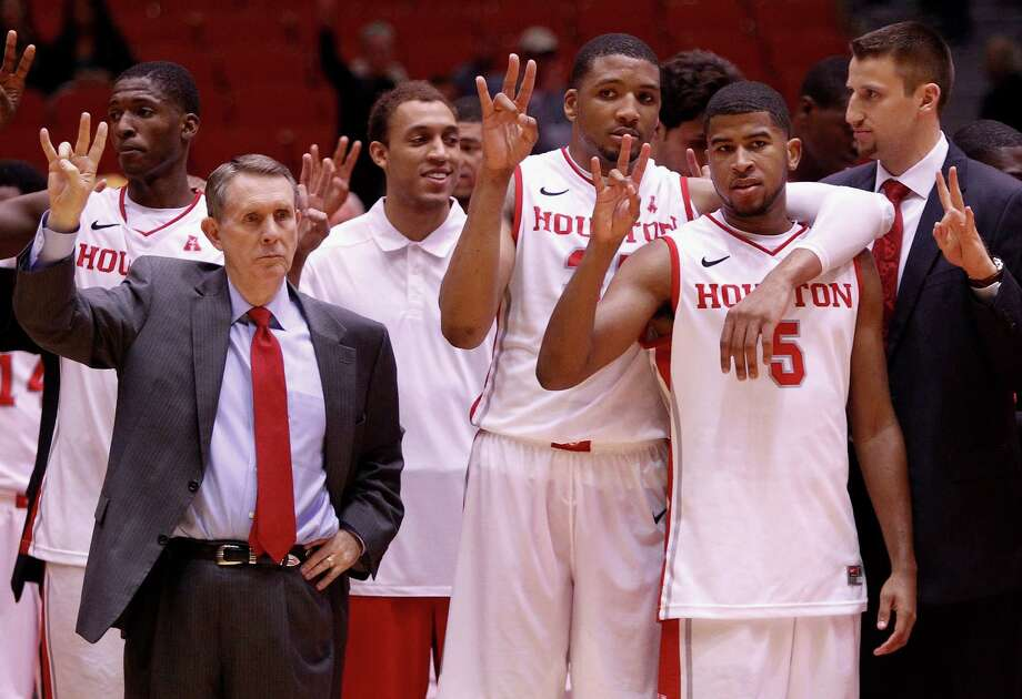 Houston Cougars head coach James Dickey along with TaShawn Thomas and L.J. Rose (5) after defeating the Texas State Bobcats 76-70 during an NCAA mens basketball game between the Texas State Bobcats and the University of Houston Cougars at Hofheinz Pavilion, Friday, Nov. 8, 2013. (Bob Levey/Special to the Chronicle) Photo: Bob Levey, Houston Chronicle / ©2013 Bob Levey