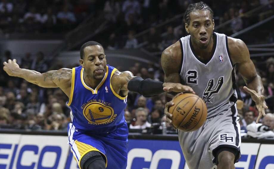 San Antonio Spurs' Kawhi Leonard looks for room around Golden State Warriors' Andre Iguodala during second half action Friday Nov. 8, 2013 at the AT&T Center. The Spurs won 76-74. Photo: Edward A. Ornelas, San Antonio Express-News