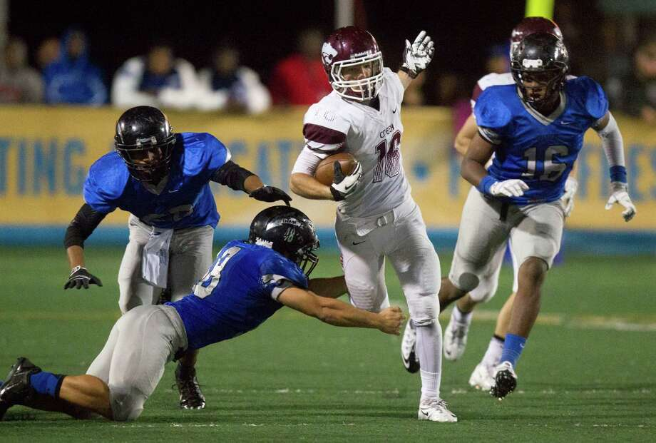 Clear Creek Andrew Wiesen looks for running room during the second half of a high school football game against Clear Springs at CCISD Veterans Stadium on Friday, Nov. 8, 2013, in League City. Photo: J. Patric Schneider, For The Chronicle / © 2013 Houston Chronicle