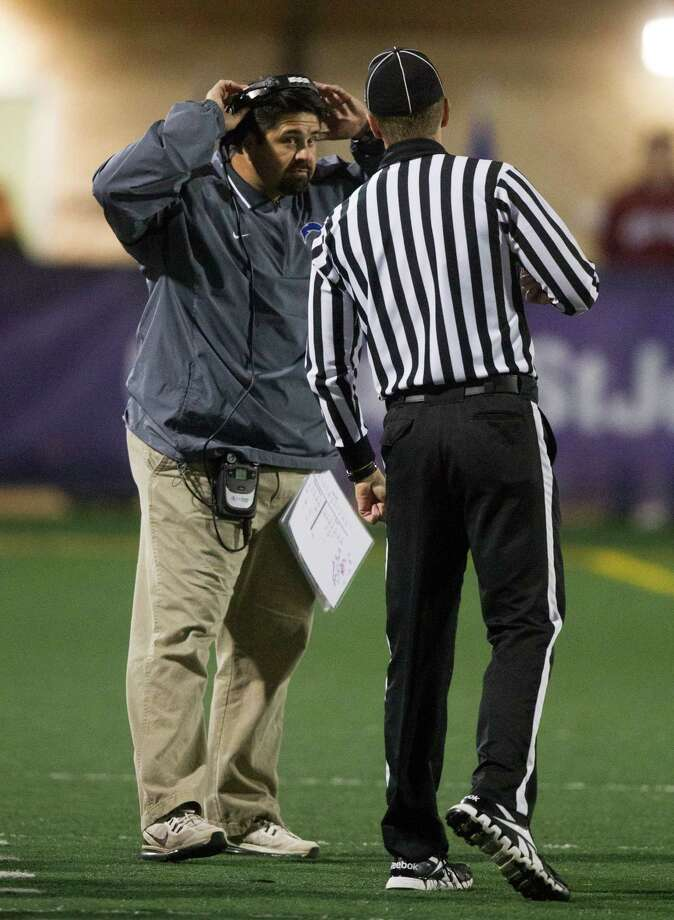 Clear Springs head coach Frank Maldonado talks with a referee during the second half of a high school football game against Clear Creek at CCISD Veterans Stadium on Friday, Nov. 8, 2013, in League City. Photo: J. Patric Schneider, For The Chronicle / © 2013 Houston Chronicle