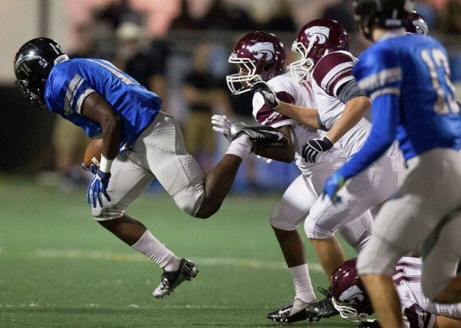 Clear Springs Joshua Washington dives for extra yards during the second half of a high school football game against Clear Creek at CCISD Veterans Stadium on Friday, Nov. 8, 2013, in League City. Photo: J. Patric Schneider, For The Chronicle / © 2013 Houston Chronicle