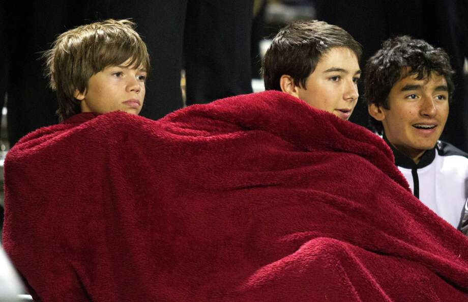 Clear Creek band members attempt to stay warm on a cool night during the second half of a high school football game against Clear Springs at CCISD Veterans Stadium on Friday, Nov. 8, 2013, in League City. Photo: J. Patric Schneider, For The Chronicle / © 2013 Houston Chronicle