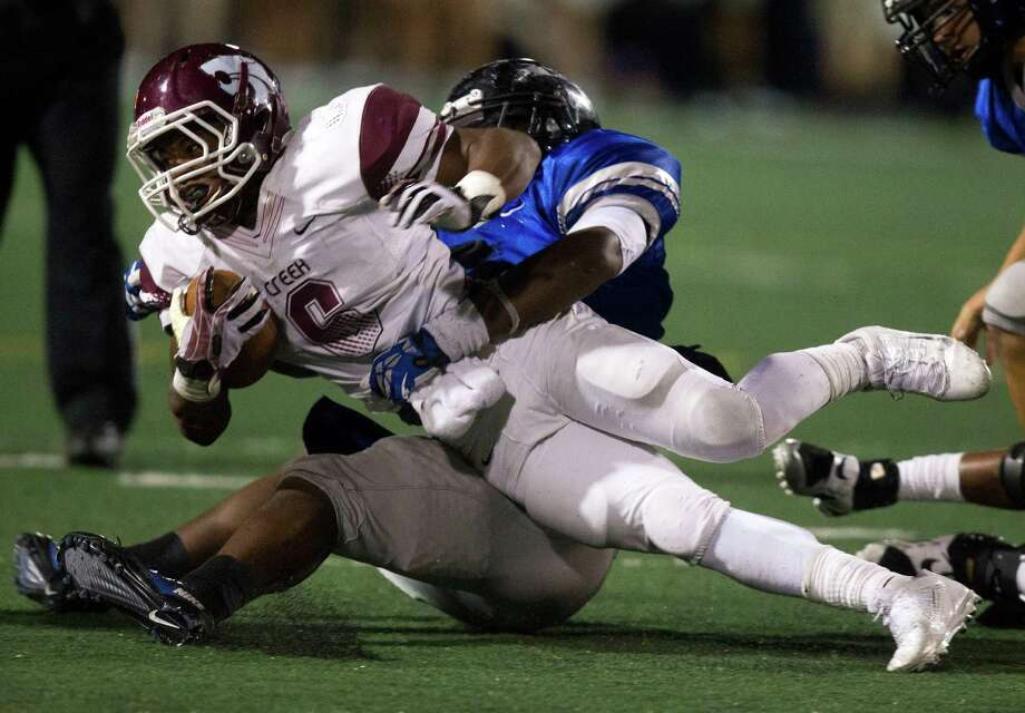 Clear Creek wide receiver Davon Smith (6) dives for a first down during the second half of a high school football game against Clear Springs at CCISD Veterans Stadium on Friday, Nov. 8, 2013, in League City. Photo: J. Patric Schneider, For The Chronicle / © 2013 Houston Chronicle