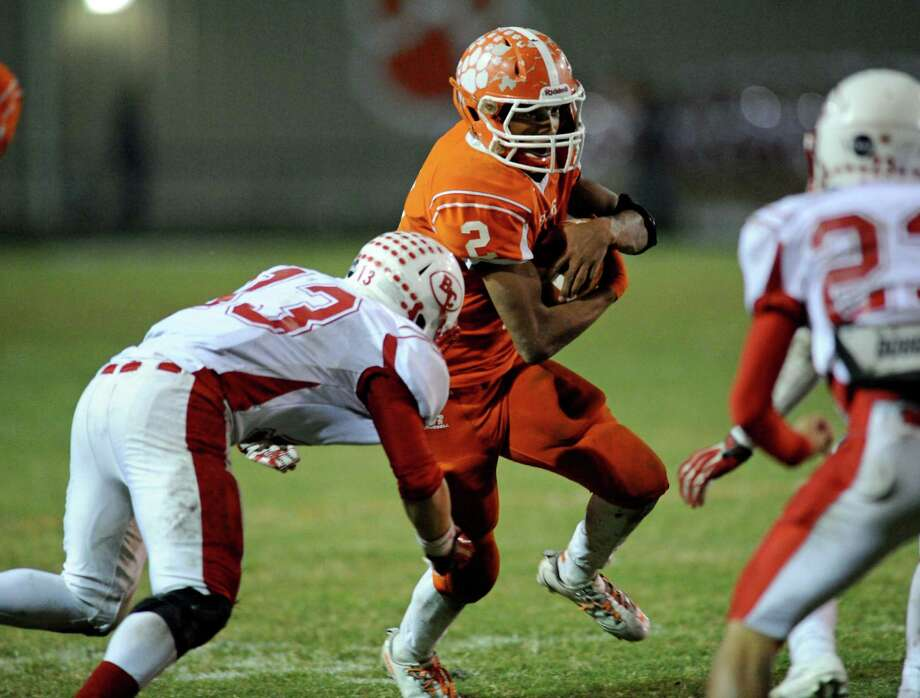 Orangefield's Carl Wiley (2) breaks away from Bridge City's Derrick Dearing (13) during a game this season. Wiley earned all-state second team honors on Tuesday. Enterprise file photo